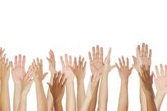 Feche acima de um grupo que levanta suas mãos Fotos de Stock