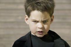 Feche acima de um menino com atitude Imagens de Stock Royalty Free