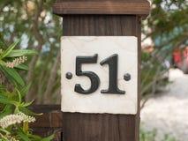 Feche acima de um número da casa 51 Imagem de Stock Royalty Free