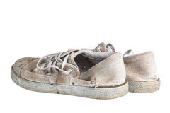 Feche acima de um par de sapatilhas sujas Isolado no fundo branco Foto de Stock Royalty Free