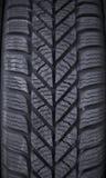Feche acima de um pneu Imagens de Stock