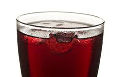 Feche acima de um vidro do suco de fruta vermelho Foto de Stock Royalty Free