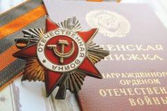 Feche acima de uma guerra patriótica da concessão, do livro da medalha e do StGe Fotografia de Stock