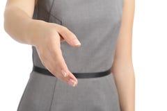 Feche acima de uma mão da mulher pronta ao aperto de mão fotografia de stock