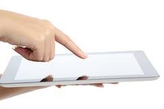 Feche acima de uma mão da mulher que toca em um PC da tabuleta Imagens de Stock Royalty Free