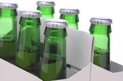 Feche acima de uns seis blocos da cerveja Foto de Stock