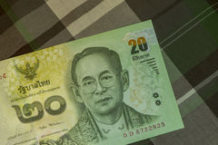 Feche acima do banho tailandês da cédula tailandesa com a imagem do rei tailandês Cédula tailandesa do baht 20 tailandês na tela  Imagem de Stock