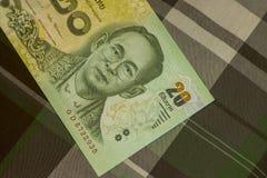 Feche acima do banho tailandês da cédula tailandesa com a imagem do rei tailandês Cédula tailandesa do baht 20 tailandês na tela  Fotos de Stock