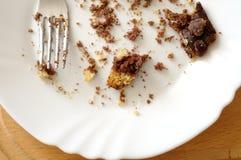 Feche acima do bolo de chocolate restante, de cima de Foto de Stock Royalty Free