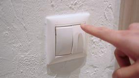 Feche acima do botão da pressão de mão para ligar a eletricidade imagens de stock royalty free