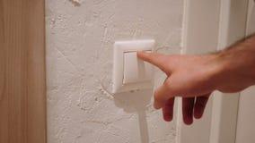 Feche acima do botão da pressão de mão para ligar a luz imagens de stock