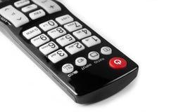 Feche acima do botão vermelho do poder no controlo a distância da tevê isolado Imagens de Stock
