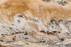 Feche acima do detalhe de vale do inferno de Noboribetsu Jigokudani: O vale do vulcão obteve seu nome do cheiro sulfúrico Imagens de Stock Royalty Free
