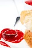 Feche acima do doce e do croissant vermelhos Fotografia de Stock