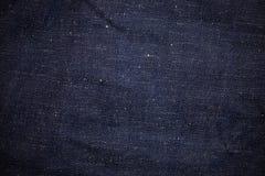 Feche acima do fundo das texturas das calças de brim imagens de stock royalty free