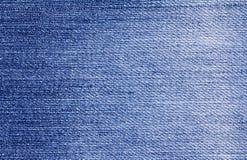 Feche acima do fundo de superfície da textura de calças de ganga da sarja de Nimes Fotografia de Stock