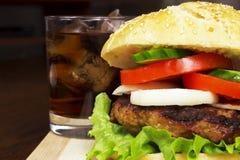 Feche acima do hamburguer & da cola Imagem de Stock Royalty Free