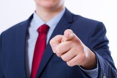 Feche acima do homem de negócio que aponta o dedo em você isolou-se no fundo branco Tela virtual tocante Esfera 3d diferente Foto de Stock Royalty Free