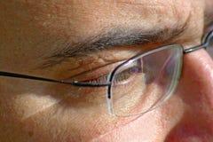 Feche acima do olho e dos vidros Fotografia de Stock Royalty Free