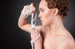 Feche acima do retrato da menina bonita com arte da face Fotos de Stock Royalty Free