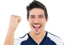 Feche acima do retrato de cheering do jogador de futebol Imagens de Stock Royalty Free