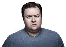 Feche acima do retrato do homem gordo no estúdio cético Isolado no fundo branco Fotografia de Stock Royalty Free