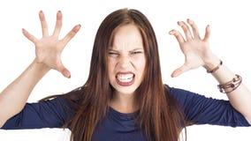 Feche acima do retrato isolado da mulher irritada irritada nova que guarda as mãos no gesto furioso Emoções humanas negativas, ca foto de stock royalty free