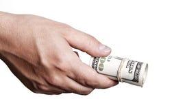 Dando para fora o dinheiro Imagem de Stock