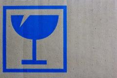 Feche acima do símbolo ao lado da caixa do vidro Imagem de Stock Royalty Free