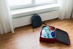 Feche acima do saco do curso com roupa e trouxa Imagem de Stock Royalty Free