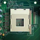 Feche acima - do soquete do processador central em um cartão-matriz do computador fotografia de stock royalty free