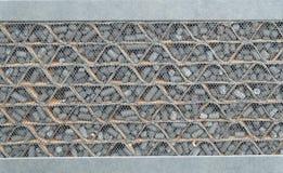 Feche acima do teste padrão do fundo da textura do filtro do carbono Fotografia de Stock Royalty Free