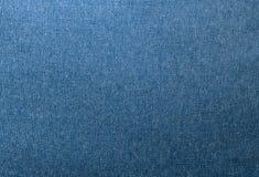 Feche acima do teste padrão do fundo da textura azul da sarja de Nimes fotografia de stock