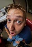 Feche acima do tiro da cara de homem novo com uma lente de Fisheye Fotografia de Stock Royalty Free