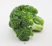 Feche acima dos brócolis isolados no branco Imagens de Stock Royalty Free