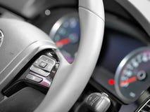 Feche acima dos comandos do volante Fotos de Stock