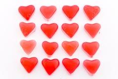 Feche acima dos corações vermelhos dos doces no quadrado Foto de Stock Royalty Free