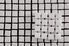 Feche acima dos cubos do açúcar branco Imagem de Stock Royalty Free