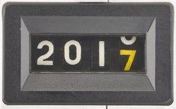 Feche acima dos dígitos de um contador mecânico Conceito do ano novo 2017 fotografia de stock royalty free