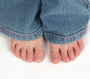 Feche acima dos dedos do pé da criança Imagem de Stock