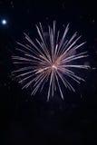Feche acima dos fogos-de-artifício com a lua no fundo Fotografia de Stock Royalty Free