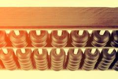 Feche acima dos grânulos de madeira de um ábaco Foc seletivo Fotografia de Stock Royalty Free