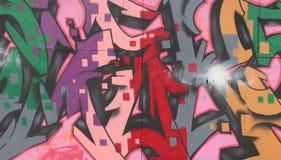 Feche acima dos grafittis em uma parede. Foto de Stock