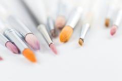 Feche acima dos pincéis coloridos Imagens de Stock