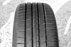 Feche acima dos pneus de carro usado do passo Fotografia de Stock Royalty Free