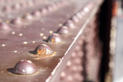Feche acima dos rebites em uma ponte velha Imagem de Stock Royalty Free