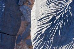 Feche acima dos testes padrões na rocha Imagens de Stock