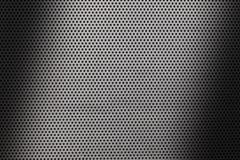 Feche acima em uma textura metálica da folha com furos e máscaras pequenos ilustração do vetor