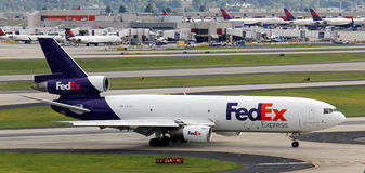 Fed Ex airplane. A fed Ex airplane on a runway at Atlanta Hartsfiled Jackson airport royalty free stock photos
