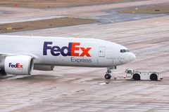 Fed ex cargo airplane at cologne bonn airport germany. Cologne, North Rhine-Westphalia/germany - 08 03 19: fed ex cargo airplane at cologne bonn airport germany royalty free stock photos